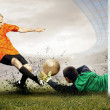Shoot of football player and jump of goalkeeper on field of — Stockfoto #6359175