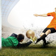 Shoot of football player and jump of goalkeeper on the field of — Stock Photo #6359176