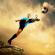 Footballer on the top of mountain — Stock Photo