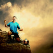 Footballer on the top of mountain - Stockfoto