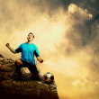 Stock Photo: Footballer on the top of mountain