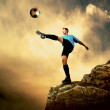 Footballer on the top of mountain — Stockfoto