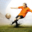 Stock Photo: Shoot of football player on field of olimpic stadium