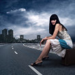 Young woman waiting on the road with her vintage baggage — Stock Photo #6359230