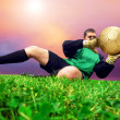 Jump of football goalman on the outdoor field — Stock fotografie