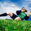 Jump of football goalman on the outdoor field — Stok fotoğraf