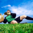 Jump of football goalman on the outdoor field — Foto Stock