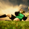 Jump of football goalman on the outdoor field — Stockfoto