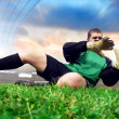 Jump of football goalman on the olimpic stadium — Stock Photo #6359342