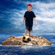 Child with soccerball on island in sea. — Stock Photo #6359386