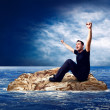 Royalty-Free Stock Photo: Man on the island in sea.
