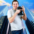 Happiness man with vintage photo camera. — Stock Photo #6359500