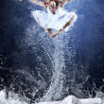 Jump of ballerina on the ice dancepool around splashes of water — Stock Photo #6359538
