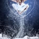 Jump of ballerina on the ice dancepool around splashes of water — Stock Photo #6359539