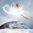 Jump of ballerina with dress of milk — Stock Photo #6359556