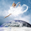 Jump of ballerina with dress of milk — Stock Photo #6359559