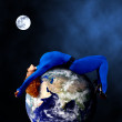 Woman in blue sleeping on the planet in space. - Foto Stock