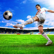 Happiness football player after goal on the field of stadium wit — Stock Photo #6359600