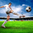 Happiness football player after goal on the field of stadium wit — Stock Photo #6359601