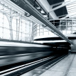 Stock Photo: Train on speed in railway station