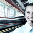 Businesswomen and train on speed in railway station — Stock Photo #6359631