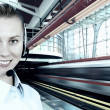 Businesswomen and train on speed in railway station — Stock Photo #6359632