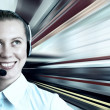 Businesswomen and train on speed in railway station — Stock Photo #6359634