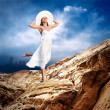 Beautiful girl in White on the mauntain under sky with clouds — Stock Photo #6359675