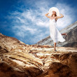 Beautiful girl in White on the mauntain under sky with clouds — Stock Photo #6359681