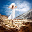 Beautiful girl in White on the mauntain under sky with clouds — Stock Photo