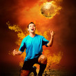 Football player in fires flame on the outdoors field — Stock Photo #6359735