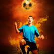 Football player in fires flame on the outdoors field — Stock Photo #6359736