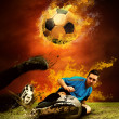 Football player in fires flame on the outdoors field — Stock Photo