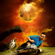 Football player in fires flame on the outdoors field — Stock Photo #6359744
