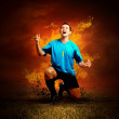 Football player in fires flame on the outdoors field — Photo
