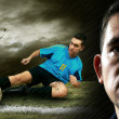 Portrait of Soccer player on the field in night rain - Stock Photo