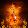 Rock guita in flames of fire - Stock Photo