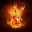 Royalty-Free Stock Photo: Rock guita in flames of fire