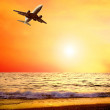 Beautiful sea nature landscape on the sunrise sky with airplane — Stock Photo #6359864
