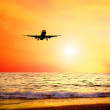 Beautiful sea nature landscape on the sunrise sky with airplane — Stock Photo #6359867