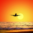 Beautiful sea nature landscape on the sunrise sky with airplane - Foto de Stock