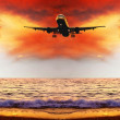 Beautiful sea nature landscape on the sunrise sky with airplane — Stock Photo #6359879