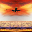 Beautiful sea nature landscape on the sunrise sky with airplane — Stock Photo