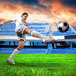 Happiness football player after goal on the field of stadium und — Stock Photo