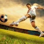 Happiness football player on field of olimpic stadium on sunrise — Stock Photo #6359904