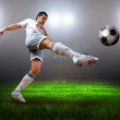 Stock Photo: Happiness football player after goal on the field of stadium wit