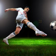 Happiness football player after goal on the field of stadium wit — Stock Photo #6359907