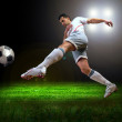 Happiness football player after goal on the field of stadium wit — Stock Photo #6359908