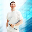 Young happy man or student with laptop on the business backgroun — Stock Photo