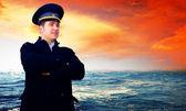 Capitan on the sea with ship — Stock Photo